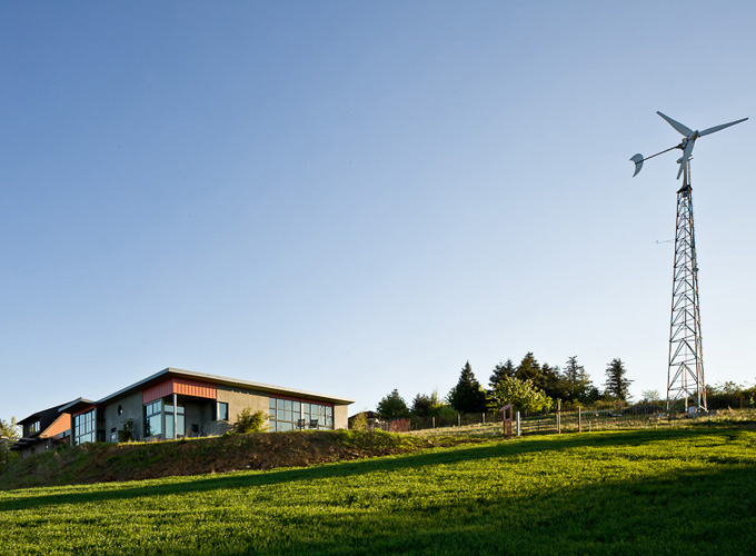 A wind turbine helps the energy efficiency of the Bald Peak home of Julie O'Toole and Steve Nemirow.