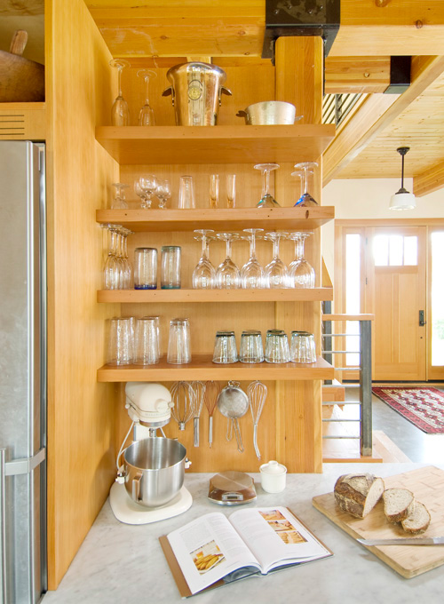Open shelving adds convenience to Davis' kitchen.