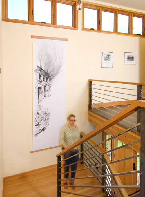 Art graces the airy stairwell.