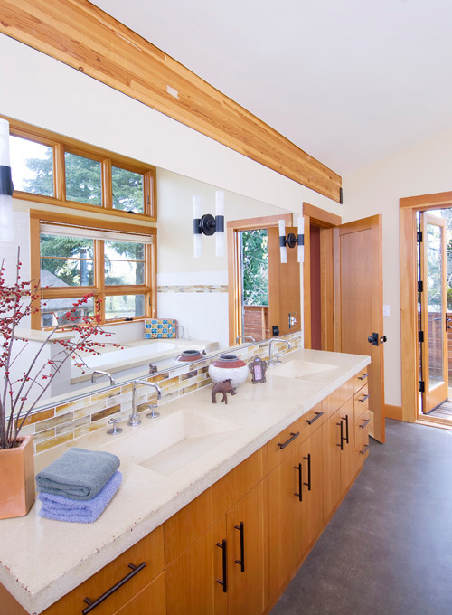 The bathrooms are full of natural light and recycled materials.