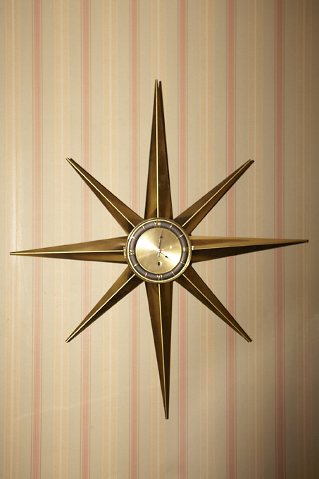 The star burst style is just one of dozens of clocks in every room of the set house, fitting for the character who does clock repair work.
